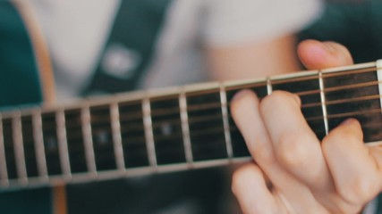 Details of performer man hands playing acoustic guitar musical