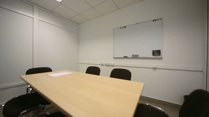 Small meeting room in office of shop selling at dealership