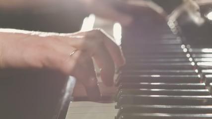 Playing piano - dramatic light