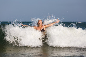 Girl in sea wave