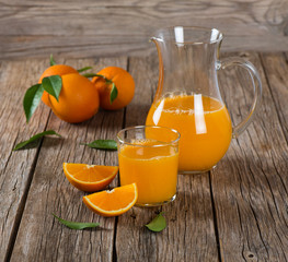 Orange ftuits and freshly squeezed juice