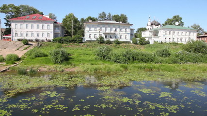 buildings of city of Vologda on river bank