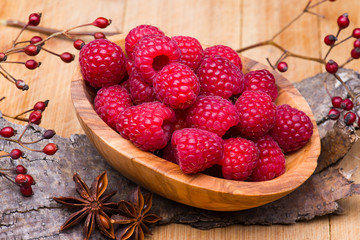 Raspberry in wood bowl