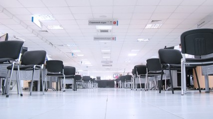 Chairs stand near workplaces in office of automobile center