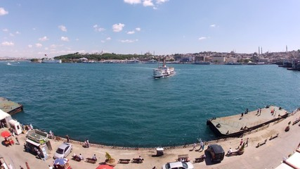 Walking ships float in bay Golden horn in afternoon, time lapse