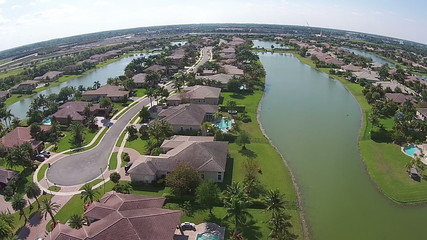 Suburban waterfront homes in Florida aerial
