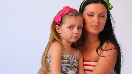 mother speaks with sad daughter, consoles it and embraces