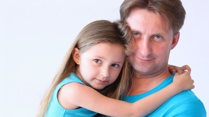 portrait of daughter on hands at father on white close up