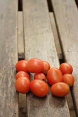 fresh tomatoes on a background of wood