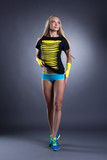 Charming long-haired blond woman in sportswear poster