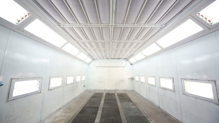Simple paint-spraying booth with metal walls for cars
