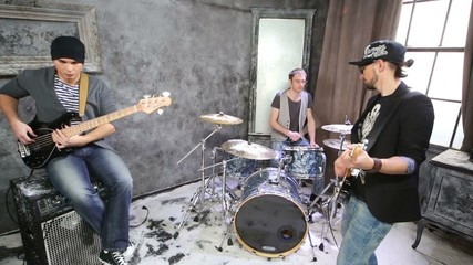 Two guitarists and drummer play in room powdered with snow