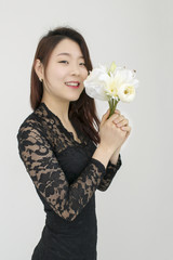 BeBeautiful asian woman with flowers