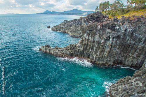 Foto Spatwand Vulkaan Jungmun Daepo coast with columnar joints at Jeju Island, South K