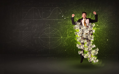 Cheerful businesman jumping with dollar banknotes around him