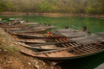 Traditional boat waiting tourists in Khao Sok National Park.