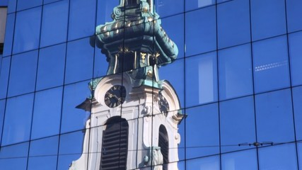Stiftskirche in reflections of high glass building