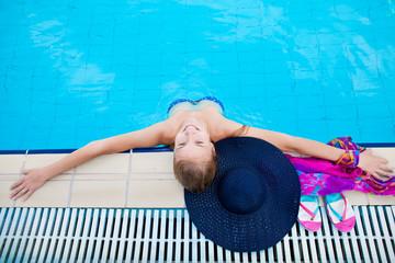 Beautiful girl in a pool of water