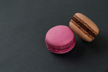 macarons on black stone background