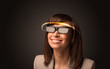 Pretty woman looking with futuristic high tech glasses