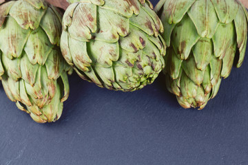 artichokes on black stone background