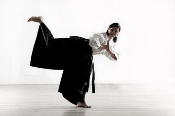 woman wearing a hakama practicing Aikido