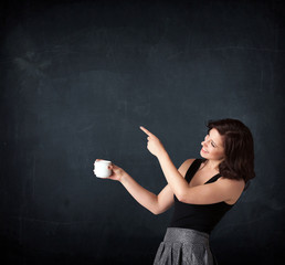 Businesswoman holding a white cup