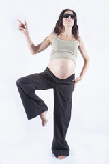 smiling pregnant woman pointing