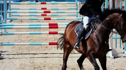 Horse with rider jumps over three barriers at competitions