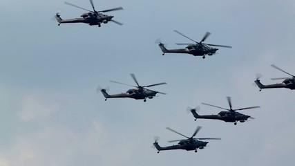 Mi-28N (Berkuts aerobatic team) fly in sky on air show
