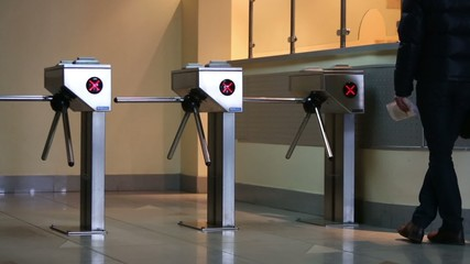 Entrance at building equipped with security turnstile