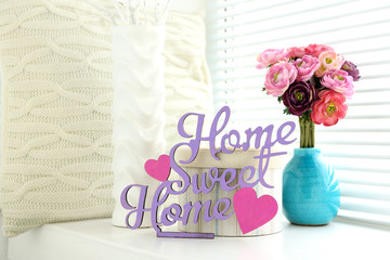 Home in colorful letters in light white interior