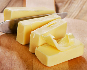 Butter on a wooden cutting board.