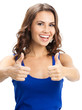 Young woman showing thumbs up gesture, over white