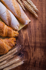 bread ears of wheat on vintage wooden board food and drink c