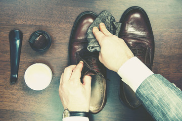 Shining and polishing leather shoes business man