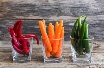 Сhili pepper and carrots in glass