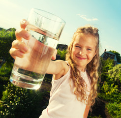 Girl holding glass with water
