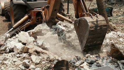 Loader Excavator Removing Debris