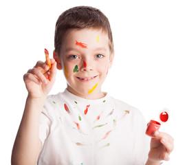 Child with paintbrush