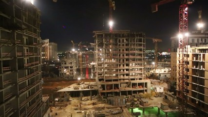 Construction site of multi-story building with illumination