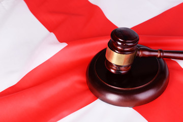 Wooden gavel on England flag background