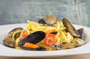 Pasta with mussels, clams and cherry tomatoes