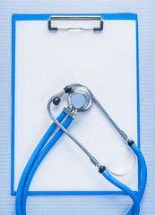 classical stethoscope on clipboard with white blank sheet of pap