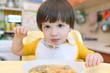 Lovely little boy eats soup