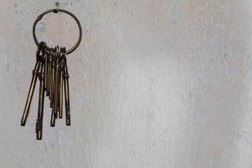 vintage keys hanging on concrete wall