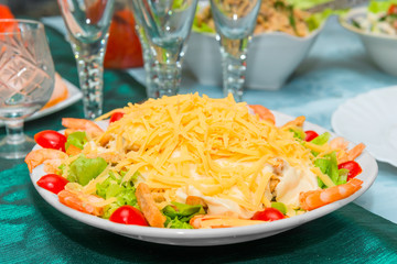 Caesar salad with shrimps in a plate