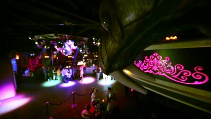 Dance floor with dancing people, view from place of metal cobra