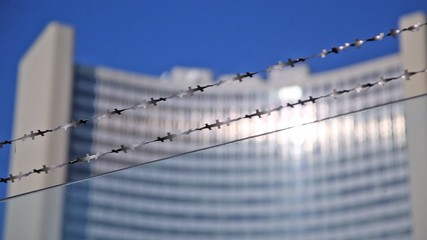 Barbed wire against UN building of United Nations in Vienna