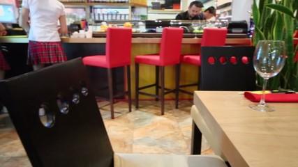 Waiter and bartenders work in bar of restaurant Kill Bill